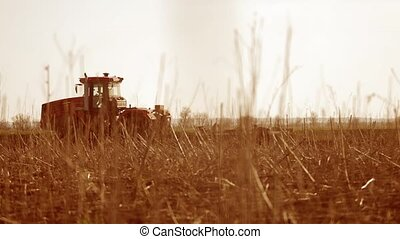 Farmer in tractor Russia agriculture soil ground preparing...