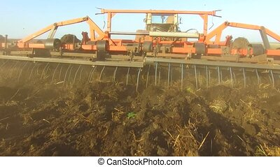 Farmer in tractor soil plows Russia steadicam motion...