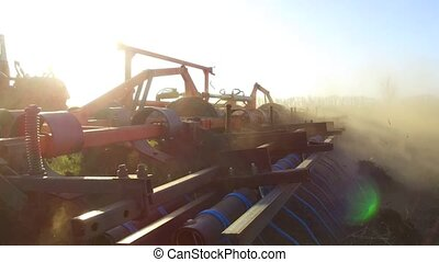 Farmer in tractor soil plows steadicam motion agriculture...