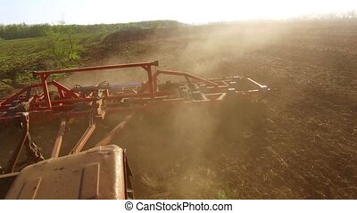 Farmer in tractor steadicam motion Russia agriculture soil...