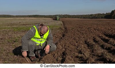 Farmer inspect to the plowing ground depth