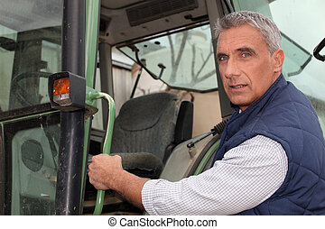 Farmer lifting on a tractor