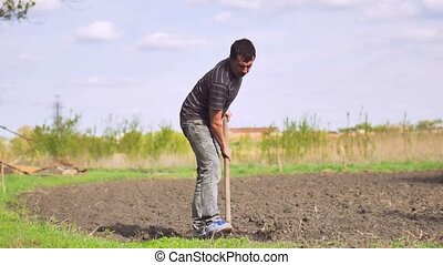 farmer man digs ground old dirty shovel on dry ground video...