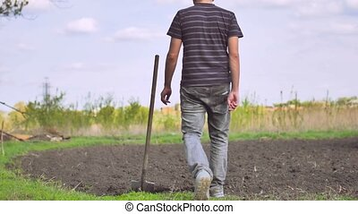 farmer man digs ground old dirty shovel on dry ground slow...