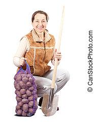 farmer, noha, aratott, krumpli, és, ásó