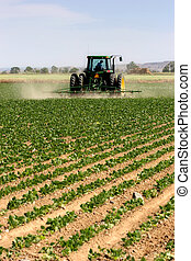 tractor plowing - farmer on his tractor plowing the field, ...