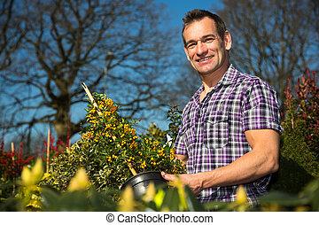 Farmer or gardener examines bush with berries