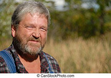 farmer - portrait of grey haired bearded farmer, wearing bib...