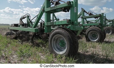 Farmer plowing the field. Small scale farming with tractor and plow in field, Cultivating tractor in the field. Farm tractor with a plow in a farm field. Tractor and Plow