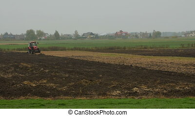 Farmer plowing the field. Small scale farming with tractor...