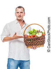 Farmer presents organic vegetables in a basket on a white background