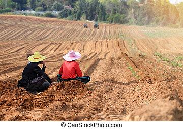 Farmer rest in a plowed potato field.