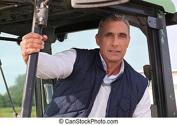 Farmer sat in his tractor