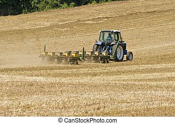 Farmer Seeding Field