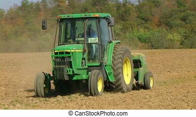 Farmer Sowing Seed 02 - Farmer sowing crop using seeder.