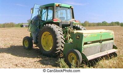 Farmer Sowing Seed - Farmer sowing crop using seeder.