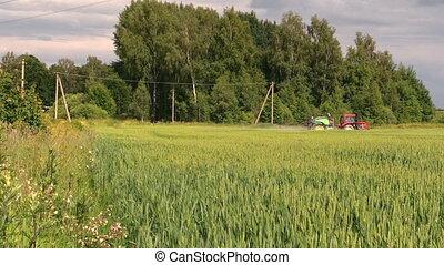 farmer spray farm field - Farm tractor spray agriculture...
