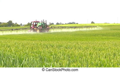 farmer spray field - Farm tractor spray summer season green...