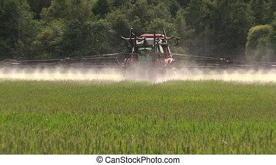 farmer spray field - Farmer with tractor spray summer season...