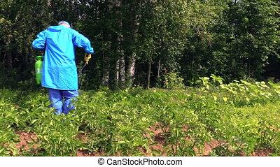 farmer spray herbicide - Peasant farmer man in protective...