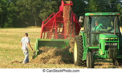 Farmer Square Baling Hay 04 - Farmer square baling hay with...