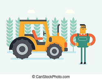 Farmer standing in the rural field with tractor.