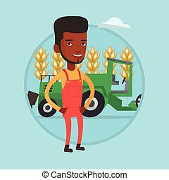Farmer standing with combine on background. - African farmer...