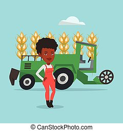 Farmer standing with combine on background. -...