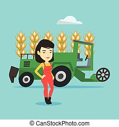Farmer standing with combine on background. - Female asian...
