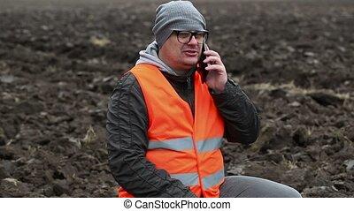 Farmer talking on smartphone
