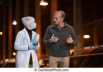 Farmer Talking to Vet at Farm