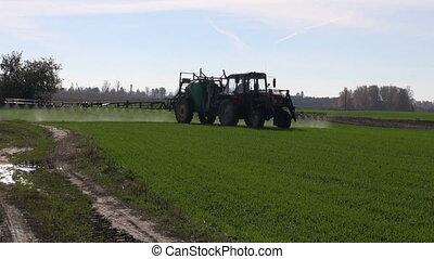 farmer tractor spraying crop - farmer tractor spraying with...