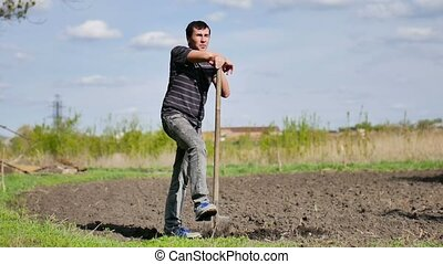 farmer weary man digs ground old dirty shovel on dry video...