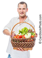 Farmer with a basket full of vegetables on a white background
