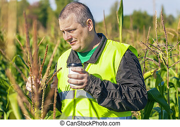 Farmer with cup of coffee