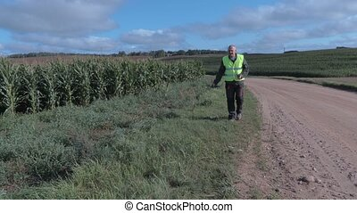 Farmer with drone at corn field