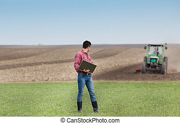 Farmer with laptop in the field
