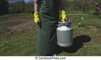 Farmer with metallic can