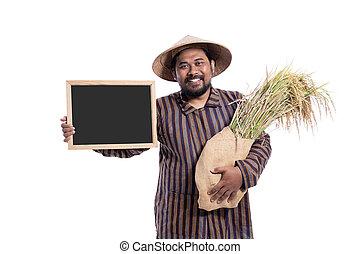 farmer with rice grain holding blank blackboard sign
