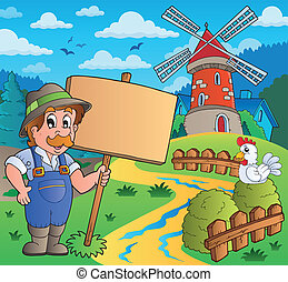 Farmer with sign near windmill