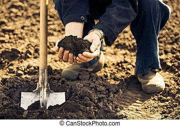 farmer with soil in palms
