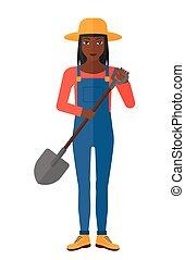 Farmer with spade. - An african-american farmer holding a...
