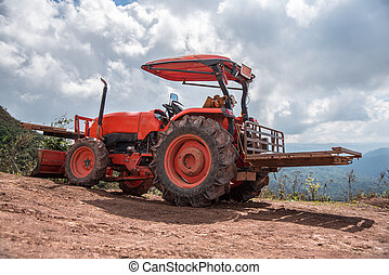 Farmer with tractor seeding crops
