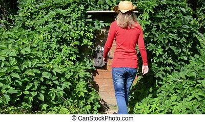 farmer woman cellar door - Farmer woman with orange sweater...