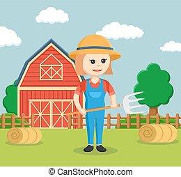 farmer woman holding pitchfork