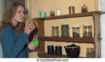 Farmer woman pick herbs for healthy natural herbal tea. 4K