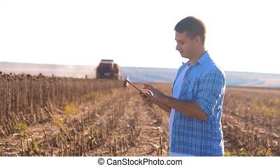 Farmer works Smart farming man read or analysis harvest...