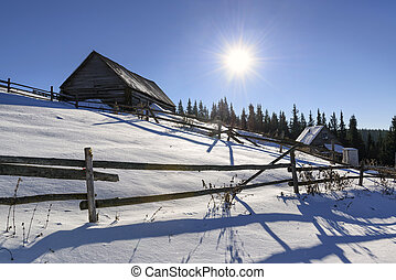 Farmers hut in the winter mountains