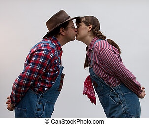 Farmers kissing. - Two country folk or farmers kissing.