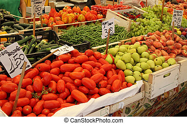 Big farmers market stall filled with organic fruits and vegetables